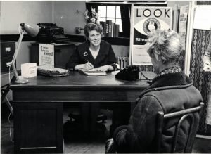 Photograph of adviser and client from the 1950's